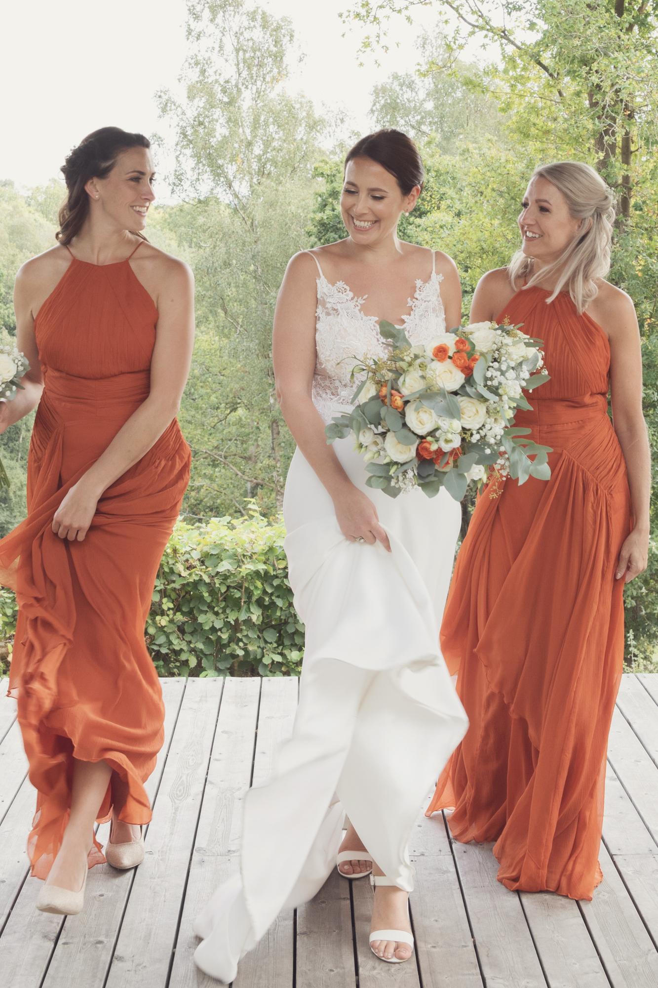 bride and bridesmaids orange dresses the beacon
