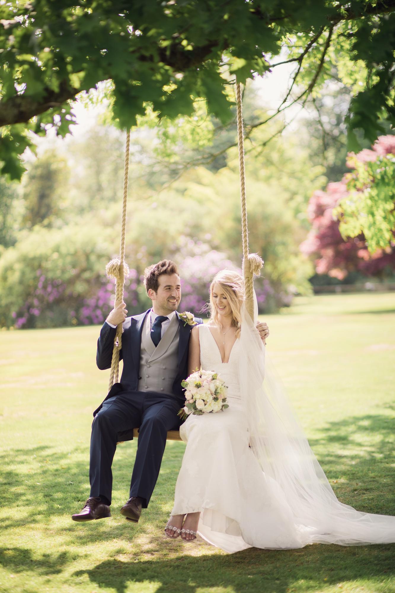 chilston park bride groom swing gardens