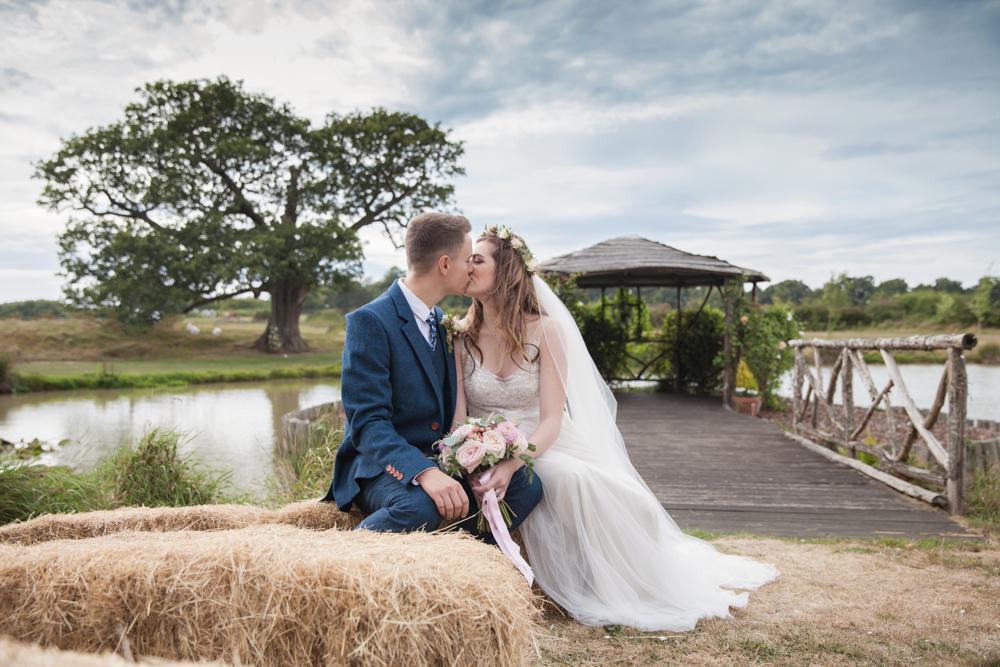 english country wedding venue couple of haybale