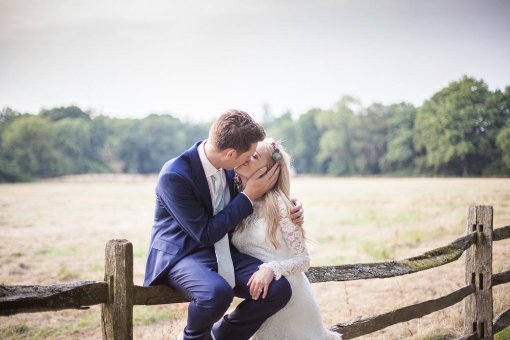 bride and groom kissing northbrook park