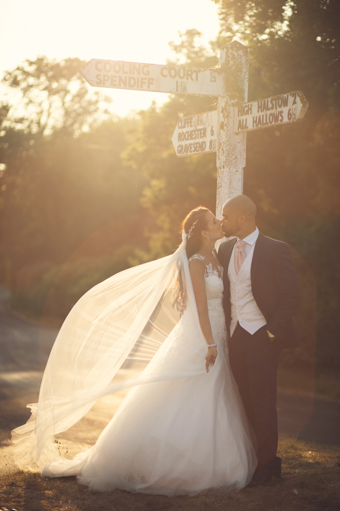 cooling castle barn wedding couple at signpost