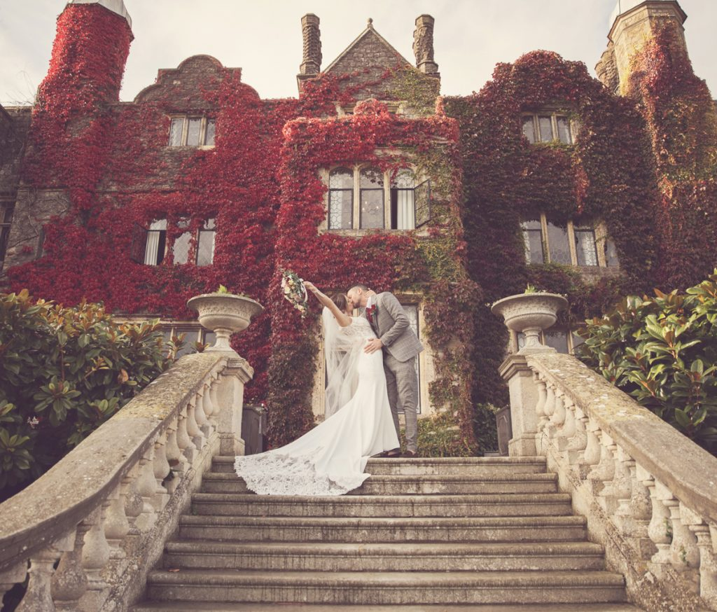 eastwell manor couple portrait front of house