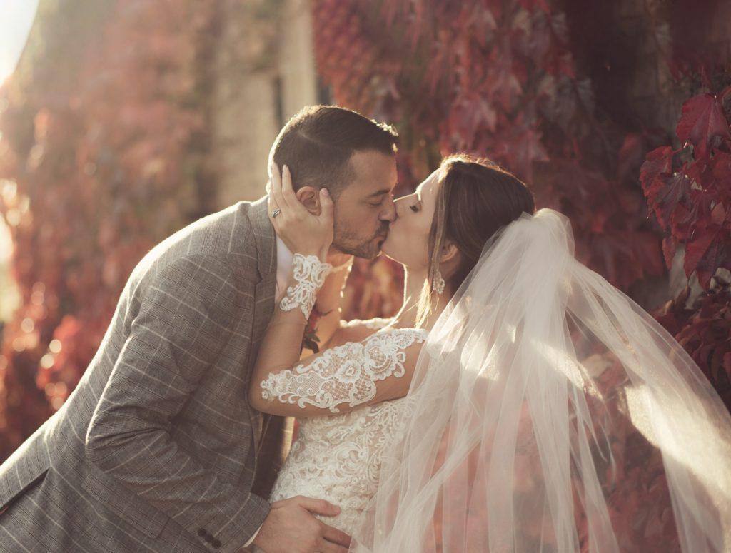 eastwell manor wedding couple kissing