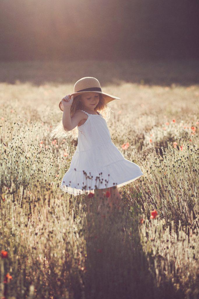 poppy field golden hour portrait