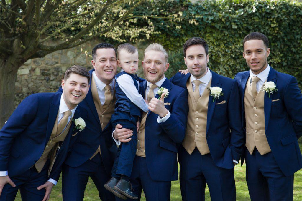 fun group photo groomsmen cooling castle