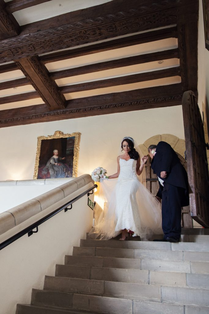 bride and father walking down stairs at leeds castle