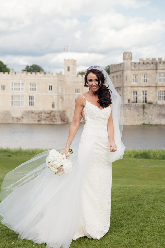 bride at front of leeds castle
