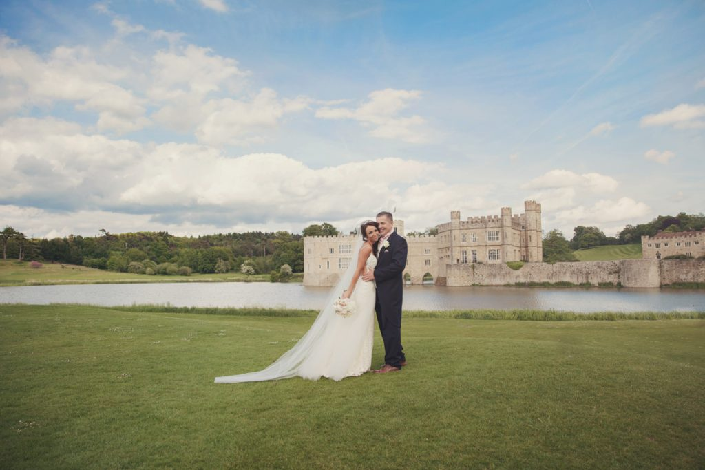 bride and groom at front of leeds castle