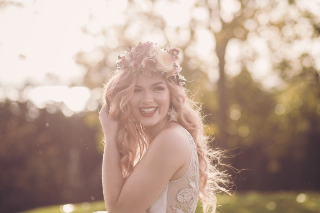 bride with flower crown in the rain
