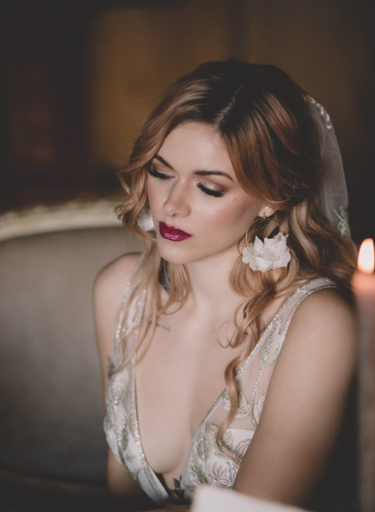 bride red lip and statement earrings